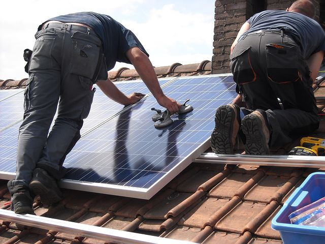 Worker Doing A Solar Panel Financing