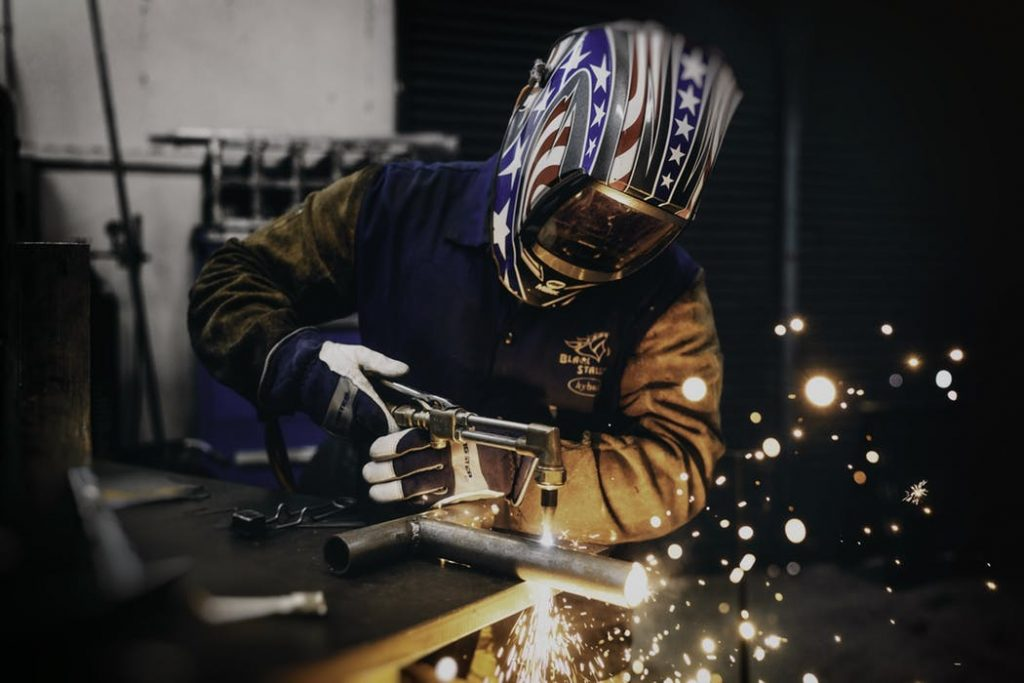 Worker while using a laser cutter