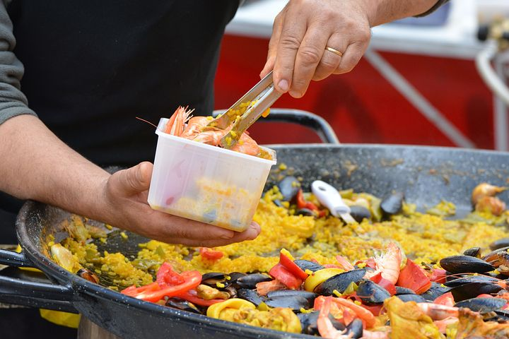 Man serving the best paella for catering in Sydney