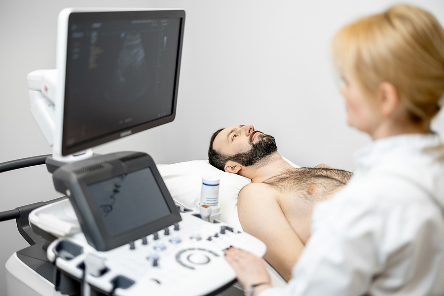 Doctor Doing A Liver Scan Procedure To A Patient
