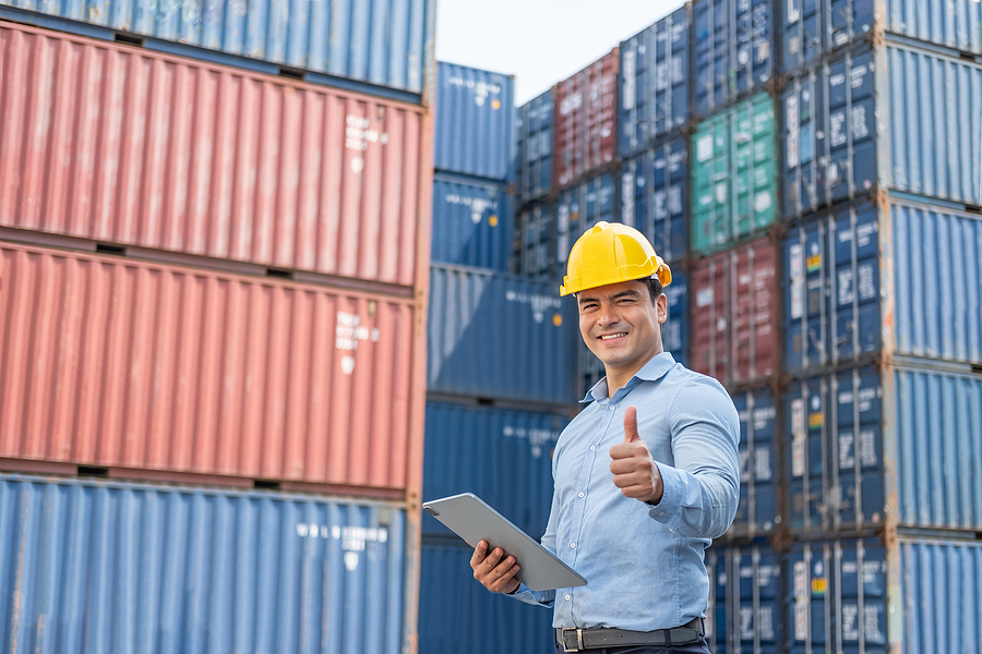 Freight Forwarding Supervisor Inspecting The Containers
