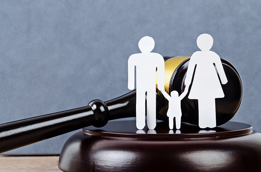 Gavel And A Family Figure. Family Law Concept