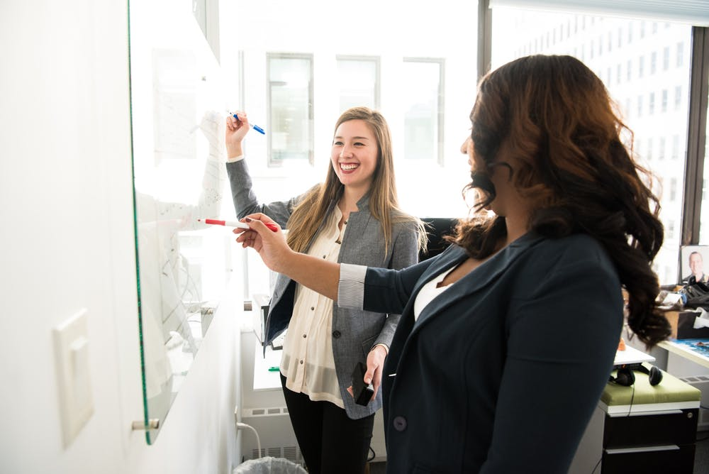 Woman taking marketing internships getting trained by her team leader